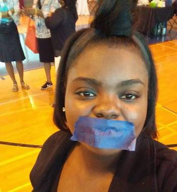 #SpeakUpMEM Woman with silence hurts tape over mouth